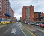 Man dies after car crashes into building in Salford